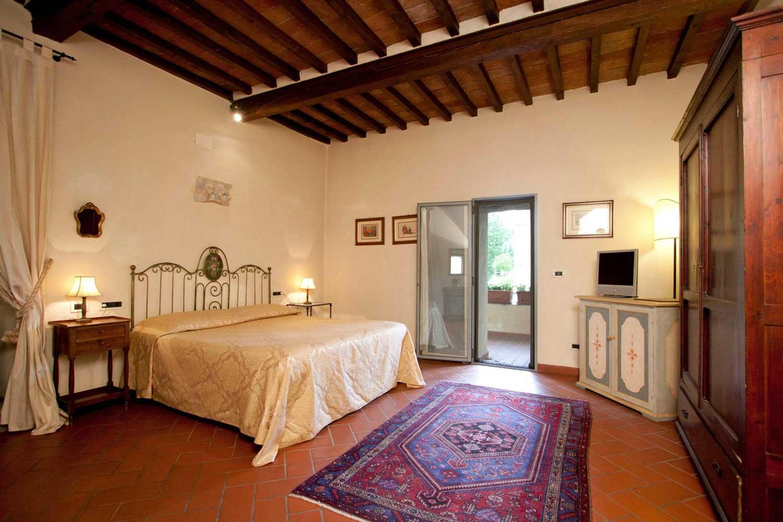 Une chambre du Relais Torre Santa Flora, hotel de charme en Toscane (Subbiano)
